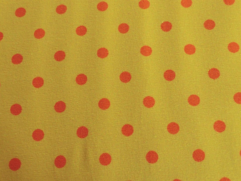 gelber Jersey mit orangenen Punkten